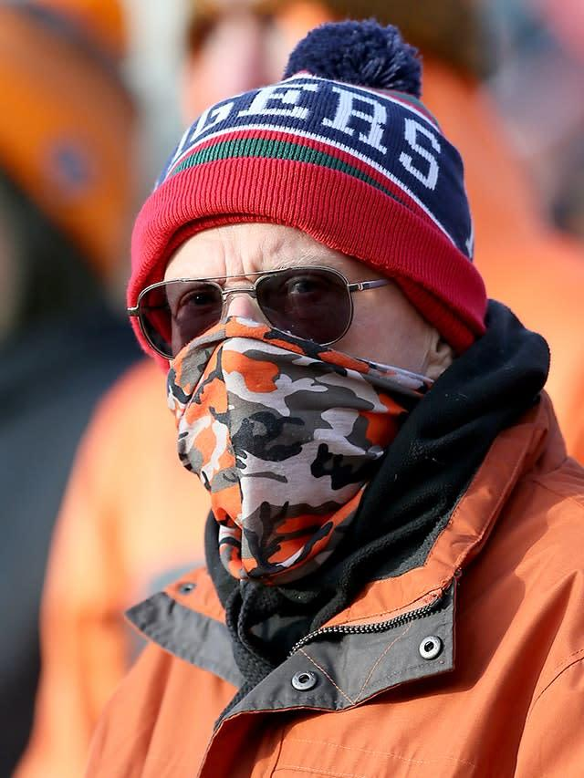 A Castleford supporter wears a mask at the Mend-A-Hose Jungle (Richard Sellers/PA)
