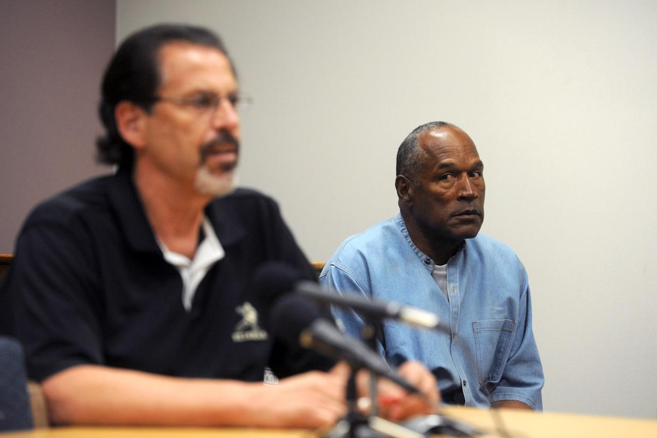 <p>O.J. Simpson reacts during the testimony of Bruce Forming during his parole hearing at Lovelock Correctional Center July 20, 2017 in Lovelock, Nevada. Simpson is serving a nine to 33 year prison term for a 2007 armed robbery and kidnapping conviction. (Photo by Jason Bean-Pool/Getty Images) </p>
