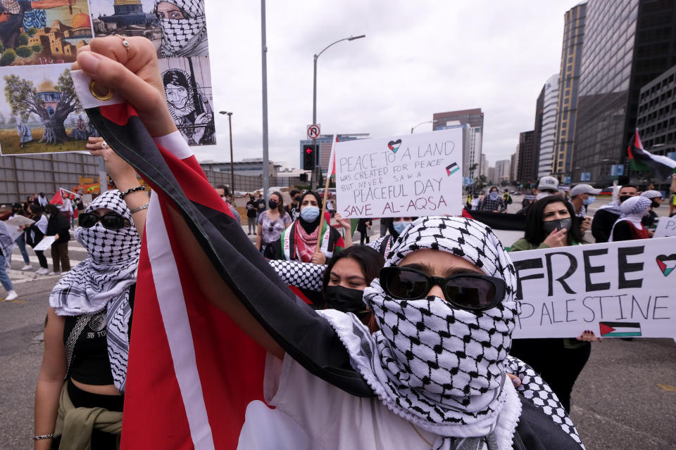 A demonstrator takes part in a protest outside the Federal Building against Israel and in support of Palestinians, Saturday, May 15, 2021 in the Westwood section of Los Angeles. (AP Photo/Ringo H.W. Chiu)