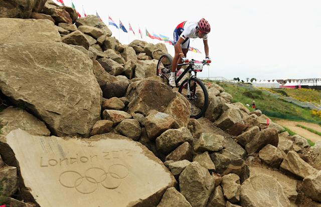 HADLEIGH, UNITED KINGDOM - AUGUST 08: A rider from Germany is seen in action during a Mountain Bike training session on Day12 of the London 2012 Olympic Games at Hadleigh Farm on August 8, 2012 in Hadleigh, England. . (Photo by Bryn Lennon/Getty Images)