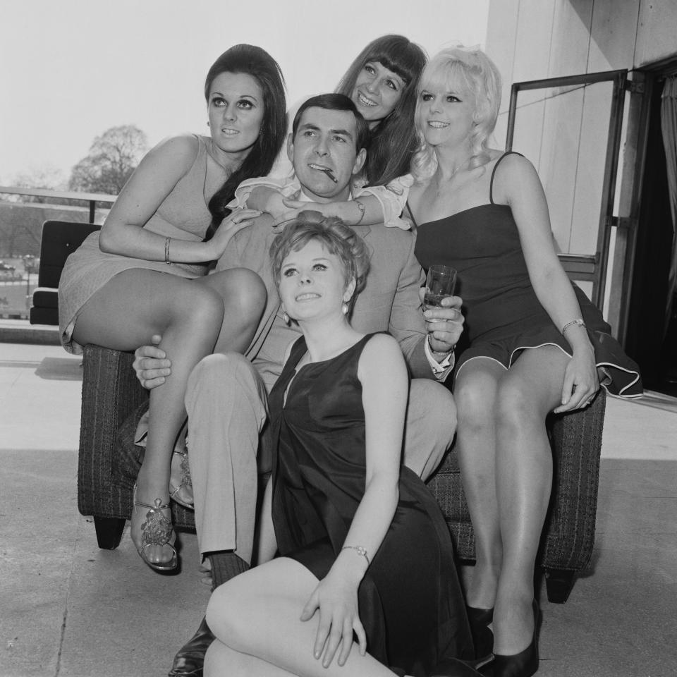 Scottish actor Neil Connery, the younger brother of actor Sean Connery, at a reception at the Hilton Hotel in London, with a group of Bond girl-style actresses, to publicise his upcoming film 'Operation Kid Brother', aka 'OK Connery', 21st April 1968. From left to right, the actresses are Sandra Marshall, Frances Sinclair, Valerie Wood, with Valerie Flower in front.   (Photo by Michael Webb/Keystone/Hulton Archive/Getty Images)