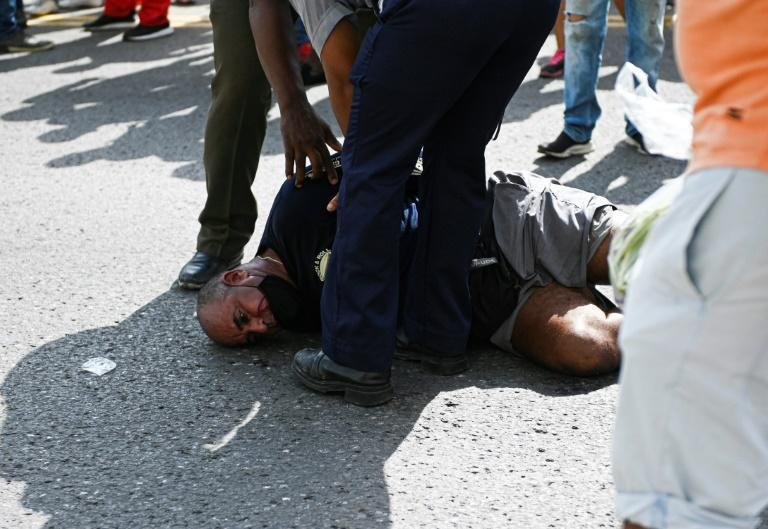 """Droves of demonstrators chanted """"Down with the dictatorship"""" in protests dispersed by police in the Cuban capital Havana"""