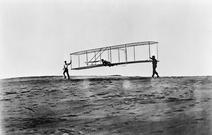 """<p>Flight is kind of a big deal these days—and the wood-frame Wright Flyer was key in making it happen. After a <a href=""""https://airandspace.si.edu/collection-objects/1903-wright-flyer/nasm_A19610048000"""" rel=""""nofollow noopener"""" target=""""_blank"""" data-ylk=""""slk:12-second flight in 1903 in Kitty Hawk, North Carolina"""" class=""""link rapid-noclick-resp"""">12-second flight in 1903 in Kitty Hawk, North Carolina</a>, Orville and Wilbur Wright continued to build upon their creation until engineering know-how pushed them to longer—and higher—places.</p>"""