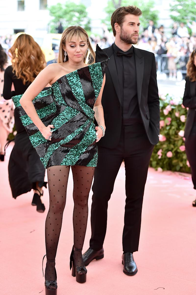 A photo of Miley Cyrus and Liam Hemsworth on the Met Gala red carpet in May 2019.