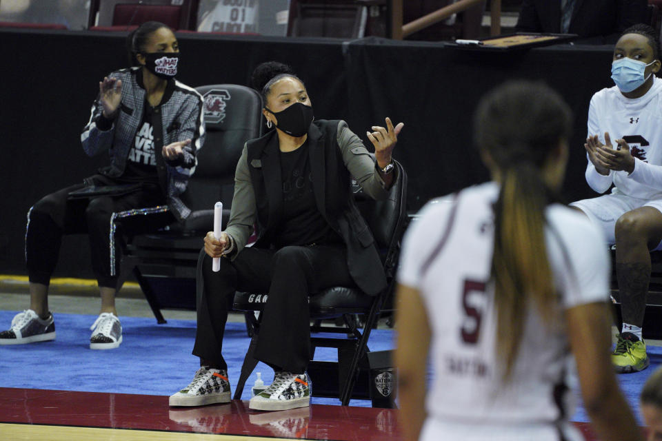 South Carolina coach Dawn Staley talks to a player during the first half of the team's NCAA college basketball game against North Carolina State on Thursday, Dec. 3, 2020, in Columbia, S.C. N.C. State won 54-46. (AP Photo/Sean Rayford)