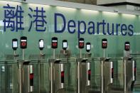 FILE PHOTO: Closed counters are seen at the departures hall of Hong Kong International Airport in Hong Kong