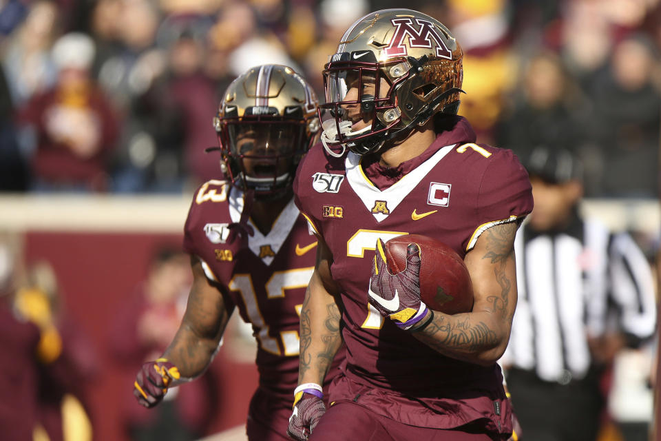 Minnesota wide receiver Chris Autman-Bell (7) carries the ball in end zone after scoring a touchdown against Penn State during an NCAA college football game, Saturday, Nov. 9, 2019, in Minneapolis. (AP Photo/Stacy Bengs)