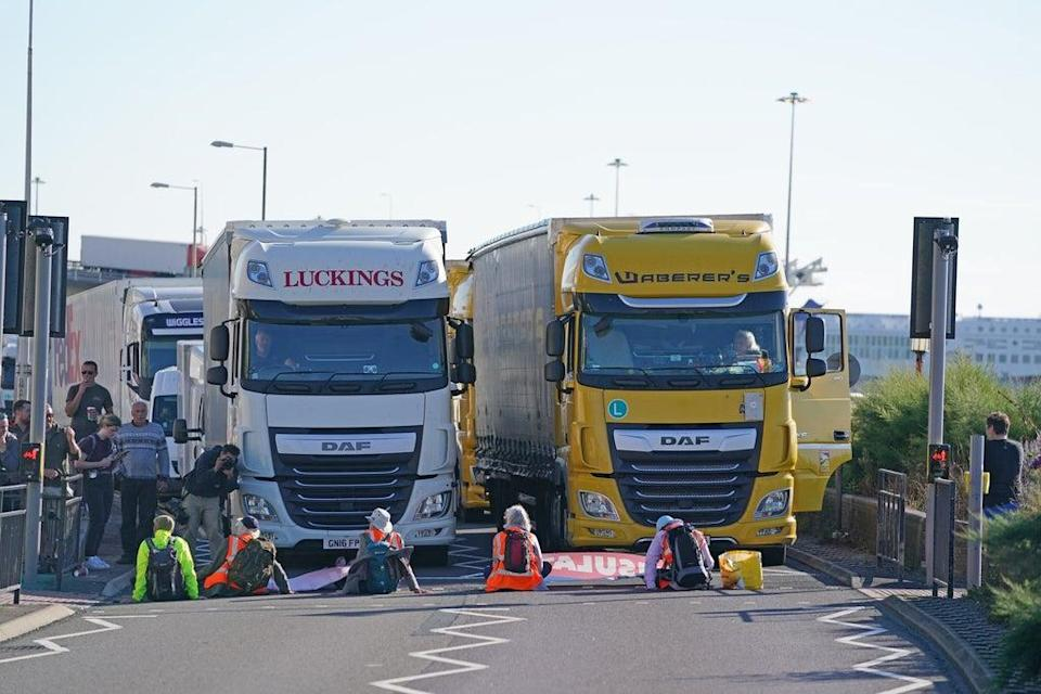 Protesters sit in front of lorries (Gareth Fuller/PA) (PA Wire)