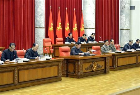 North Korean leader Kim Jong Un (front C) attends a meeting of the ruling Workers' Party politburo in Pyongyang, in this undated photo released by North Korea's Korean Central News Agency (KCNA) December 9, 2013. REUTERS/KCNA