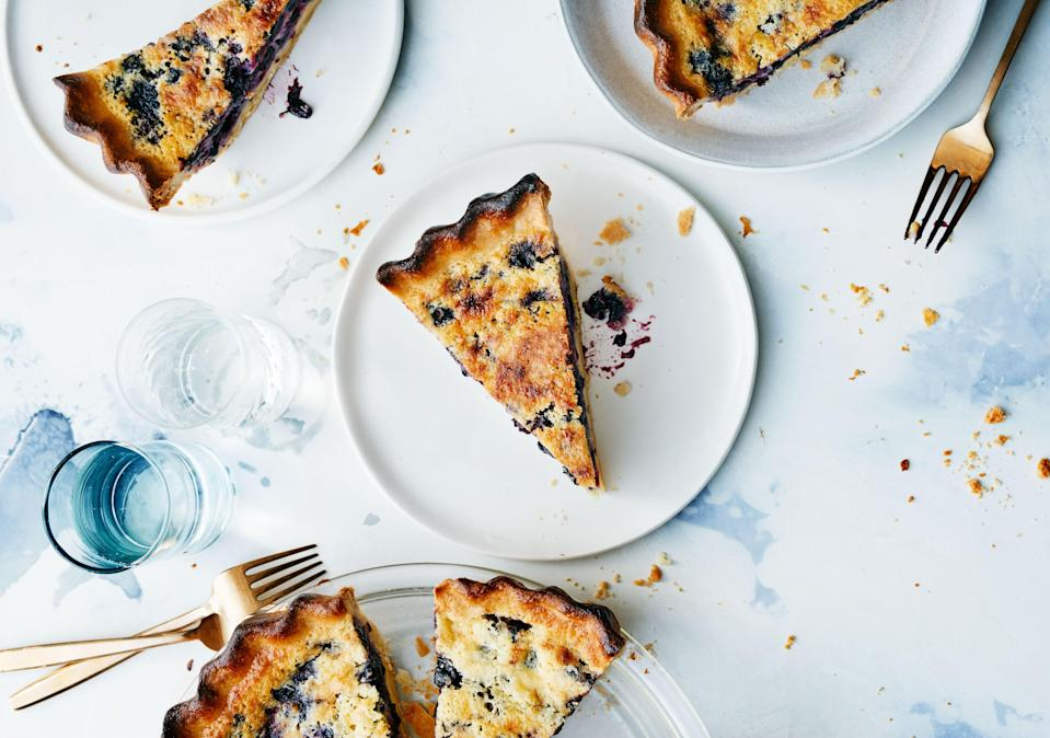 """Parbaking the crust of this blueberry pancake–flavored custard pie ensures the bottom will be crisp when it's done. <a href=""""https://www.bonappetit.com/recipe/blueberry-buttermilk-chess-pie?mbid=synd_yahoo_rss"""" rel=""""nofollow noopener"""" target=""""_blank"""" data-ylk=""""slk:See recipe."""" class=""""link rapid-noclick-resp"""">See recipe.</a>"""