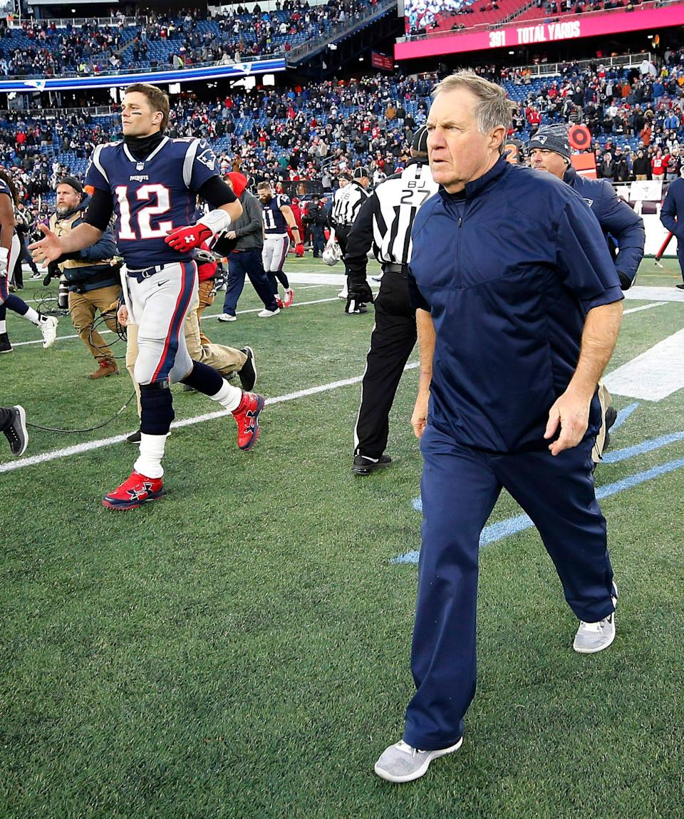 New England Patriots quarterback Tom Brady (12) and head coach Bill Belichick head out onto the field to shake hands with the Buffalo Bills after their 24-12 win at Gillette Stadium on Dec. 23, 2018.