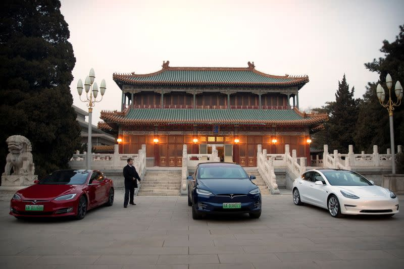 FILE PHOTO: Tesla vehicles are parked outside of a building at the Zhongnanhai leadership compound during a meeting between Tesla CEO Elon Musk and Chinese Premier Li Keqiang in Beijing