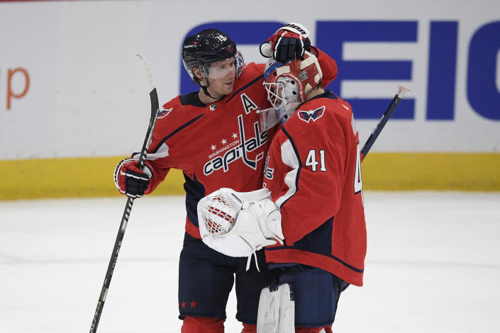 Washington Capitals center Nicklas Backstrom (19) and goaltender Vitek Vanecek (41) celebrate after an NHL hockey game against the Buffalo Sabres, Friday, Jan. 22, 2021, in Washington. The Capitals won 4-3 in a shootout. (AP Photo/Nick Wass)