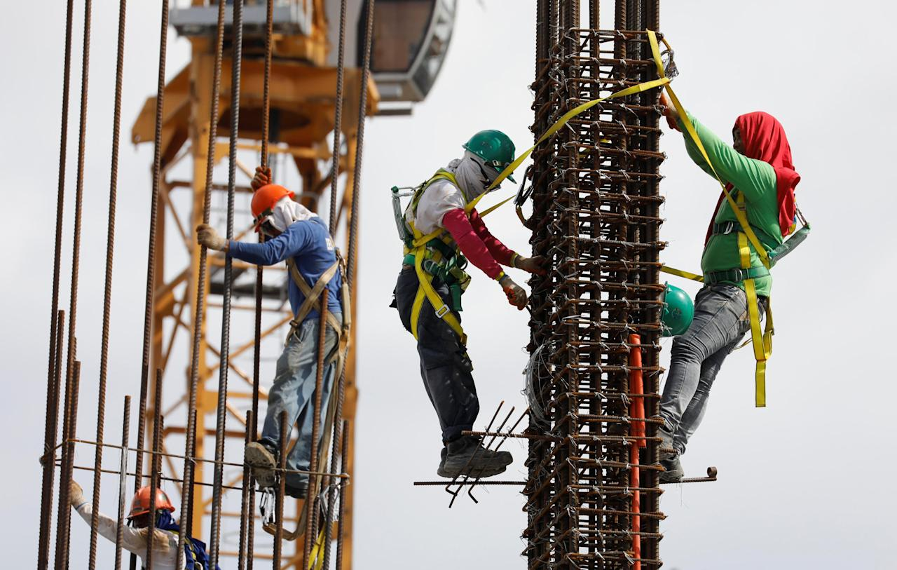 Construction workers are pictured at the construction site of an apartment building in Pasay, Metro Manila in the Philippines May 22, 2017. REUTERS/Erik De Castro