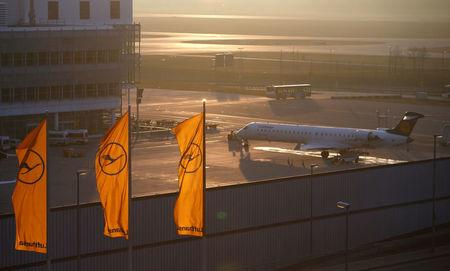 A plane by Lufthansa is seen next to Lufthansa flags at the international airport in Munich, Germany, January 9, 2018.    REUTERS/Michaela Rehle