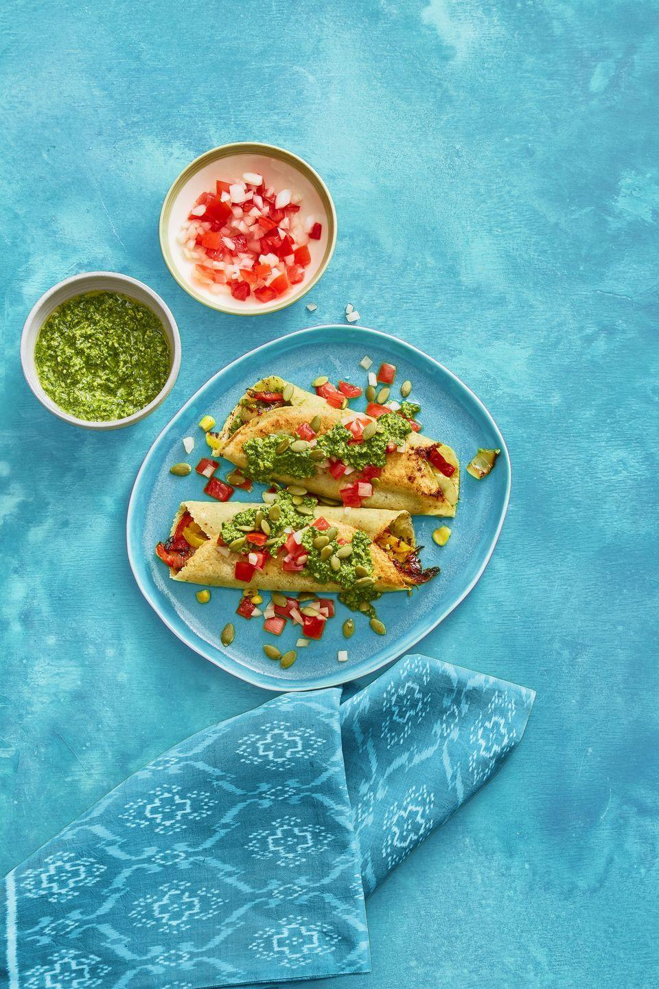 """<p>These enchiladas are proof that you enjoy pumpkin all year long.</p><p><a href=""""https://www.womansday.com/food-recipes/food-drinks/recipes/a60792/enchiladas-with-pumpkin-seed-salsa-recipe/"""" rel=""""nofollow noopener"""" target=""""_blank"""" data-ylk=""""slk:Get the Enchiladas with Pumpkin Seed Salsa recipe."""" class=""""link rapid-noclick-resp""""><em>Get the Enchiladas with Pumpkin Seed Salsa recipe.</em></a></p>"""