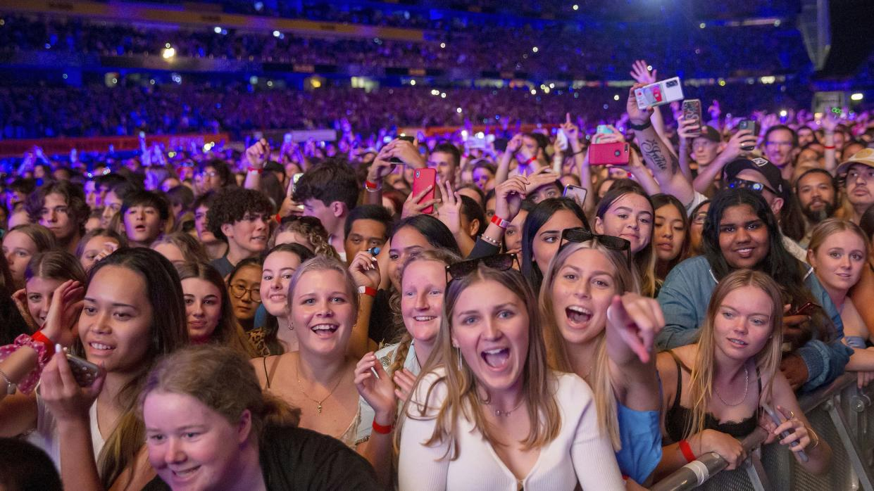 Fans react as New Zealand band Six60 perform at Eden Park in Auckland, New Zealand, on Saturday.