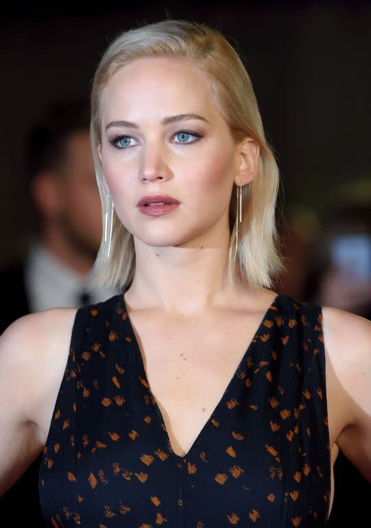 "<p>Lawrence's sleek hair look is paired with defined cheekbones and a plum stained lip. For a lip shade like J. Law's, try <a href=""http://www.ulta.com/ulta/browse/productDetail.jsp?productId=xlsImpprod4410269#"" rel=""nofollow noopener"" target=""_blank"" data-ylk=""slk:Revlon Just Bitten Kissable Balm Stain in Smitten"" class=""link rapid-noclick-resp"">Revlon Just Bitten Kissable Balm Stain in Smitten</a>. ($10) <i>(Photo: Getty)</i></p>"