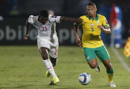 Senegal's Lamine Gassama (L) challenges South Africa's Andile Jali during their 2015 African Cup of Nations Group C soccer match in Mongomo