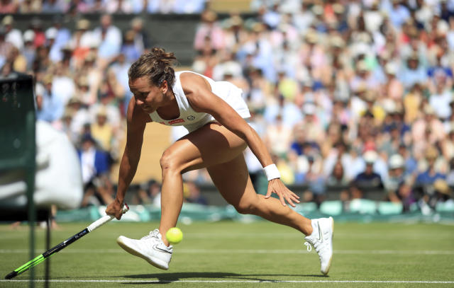 Czech Republic's Barbora Strycova overruns the ball as she tries to return to United States' Serena Williams in a Women's semifinal singles match on day ten of the Wimbledon Tennis Championships in London, Thursday, July 11, 2019. (Adam Davy/Pool Photo via AP)