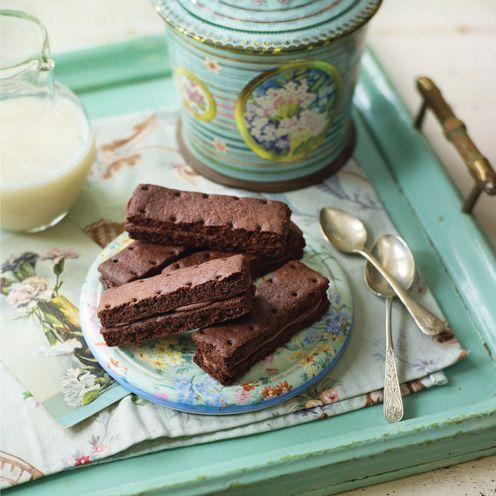 """<p>These addictive biscuits are easy to master – and well worth the effort!<br><br><strong>Recipe:</strong> <a href=""""https://www.goodhousekeeping.com/uk/food/recipes/bourbons-biscuits"""" rel=""""nofollow noopener"""" target=""""_blank"""" data-ylk=""""slk:Bourbons"""" class=""""link rapid-noclick-resp"""">Bourbons</a><br> </p>"""