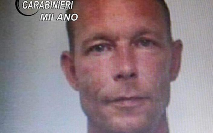 CORRECTION - A handout picture taken in 2018 and released by Italian Carabinieri on June 5, 2020 shows Christian B. when he was arrested for drug trafficking in Italy. - - AFP