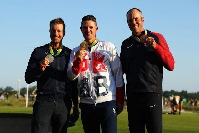 The Olympic golf medalists show off their medals. (Getty Images)