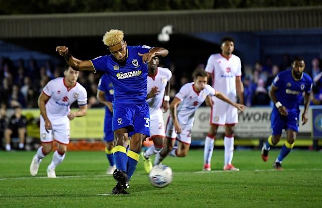 "Soccer Football - League One - AFC Wimbledon vs Milton Keynes Dons - Kingsmeadow, London, Britain - September 22, 2017 AFC Wimbledon's Lyle Taylor misses a penalty Action Images/Tony O'Brien EDITORIAL USE ONLY. No use with unauthorized audio, video, data, fixture lists, club/league logos or ""live"" services. Online in-match use limited to 75 images, no video emulation. No use in betting, games or single club/league/player publications. Please contact your account representative for further details."