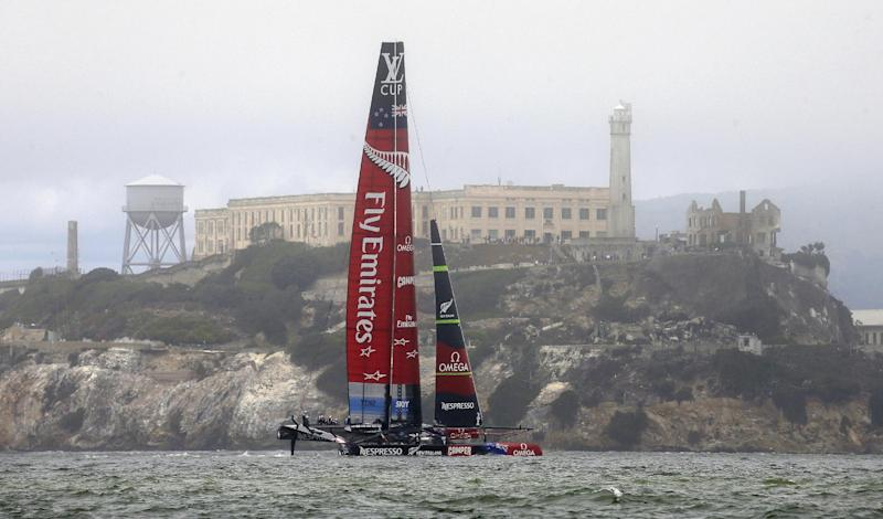 Emirates Team New Zealand passes Alcatraz Island during the eighth race of their America's Cup challenger series final sailing event against Luna Rossa Challenge, of Italy, Sunday, Aug. 25, 2013, in San Francisco. Emirates Team New Zealand won the race and series and will compete against Oracle Team USA next month. (AP Photo/Eric Risberg)