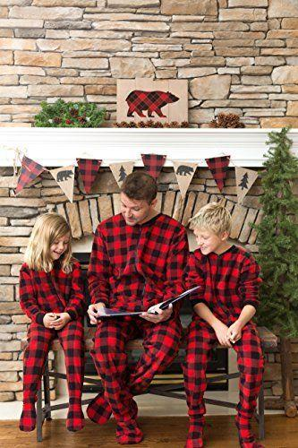 """<p><strong>SleepytimePjs</strong></p><p><strong>$15.99</strong></p><p><a href=""""https://www.amazon.com/dp/B07X5617FQ/ref=dp_prsubs_2?tag=syn-yahoo-20&ascsubtag=%5Bartid%7C10050.g.4956%5Bsrc%7Cyahoo-us"""" rel=""""nofollow noopener"""" target=""""_blank"""" data-ylk=""""slk:Shop Now"""" class=""""link rapid-noclick-resp"""">Shop Now</a></p><p>You won't get cold feet opening presents in these plaid footie pajamas. </p>"""