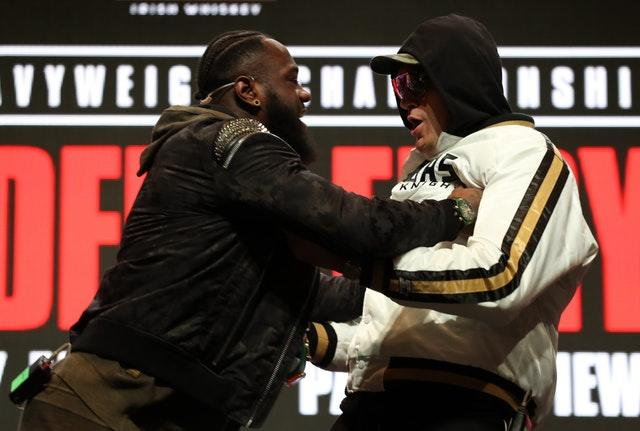 Deontay Wilder and Tyson Fury clashed at their press conference on Wednesday (Bradley Collyer/PA)