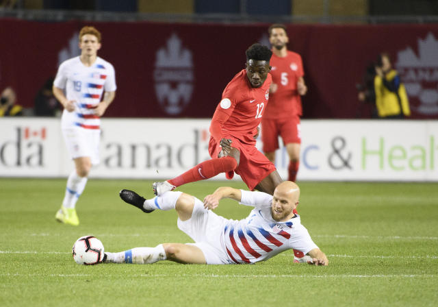 Michael Bradley (bottom) and the USMNT hit their lowest point since failing to qualify for the 2018 World Cup against Alphonso Davies and Canada. (USA Today)