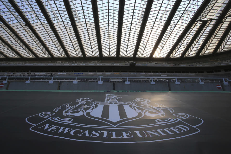 FILE - In this Wednesday, June 24, 2020 file photo, empty seats during the English Premier League soccer match between Newcastle United and Aston Villa at St James' Park stadium in Newcastle, England. English Premier League club Newcastle was taken over by Saudi Arabia's sovereign wealth fund on Thursday, Oct. 7, 2021 after a protracted takeover. The takeover by the Saudi Public Investment Fund initially collapsed last year over concerns about how much control the kingdom's leadership would have in the running of Newcastle amid concerns about Saudi human rights abuses and the pirating of sports rights. (Lindsey Parnaby/Pool via AP, File)