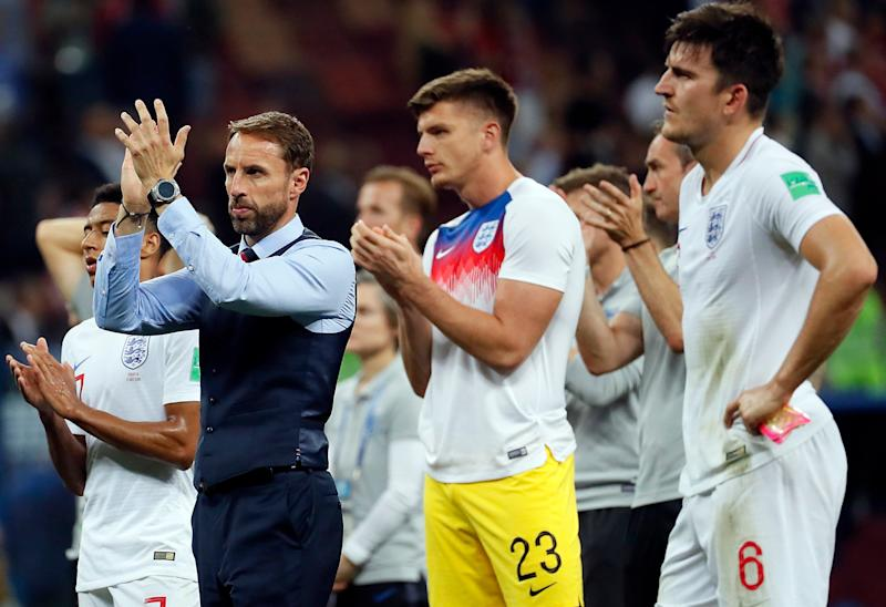 Gareth Southgate leads the team in a round of applause to fans after they were knocked out of the World Cup: EPA