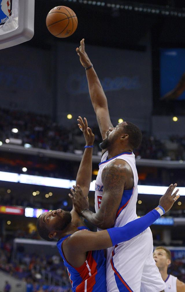Los Angeles Clippers center DeAndre Jordan, right, shoots as Detroit Pistons forward Greg Monroe defends during the first half of an NBA basketball game, Saturday, March 22, 2014, in Los Angeles. (AP Photo/Mark J. Terrill)