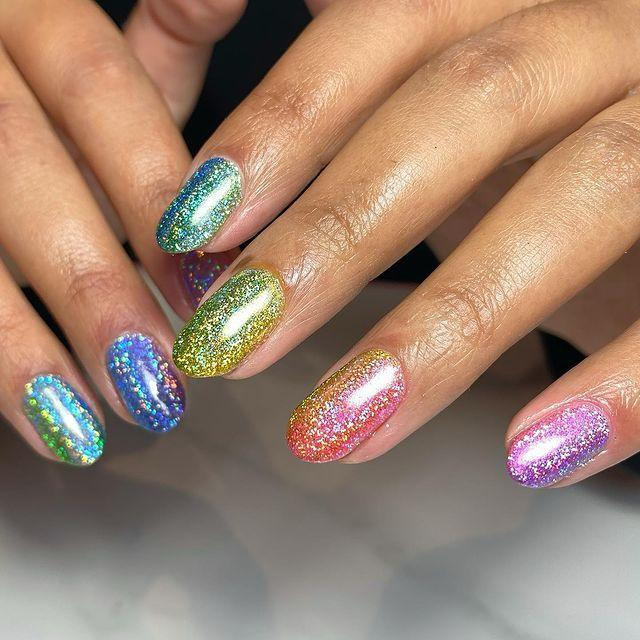 """<p>Can't decide on one shade? Draw inspiration from a 2000s sticker sheet and go holographic.</p><p><a href=""""https://www.instagram.com/p/CJ__O4GMBe5/"""" rel=""""nofollow noopener"""" target=""""_blank"""" data-ylk=""""slk:See the original post on Instagram"""" class=""""link rapid-noclick-resp"""">See the original post on Instagram</a></p>"""
