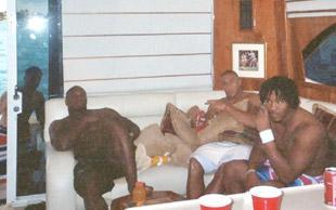Nevin Shapiro said this photo was taken in the summer of 2003 in the lounge of his $1.6 million yacht. Seated from left to right are D.J. Williams, Kellen Winslow Jr. and then-Nebraska defensive end Benard Thomas.