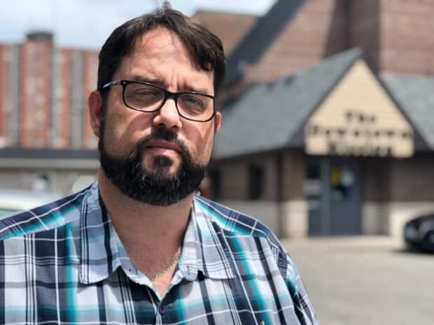 The Downtown Mission's executive director Ron Dunn says if the shelter can't work out a new deal with the owner of the McDougall Street site, the organization may have to settle for relocating to the corner of Ouellette Avenue and Elliott Street. (Amy Dodge/CBC - image credit)