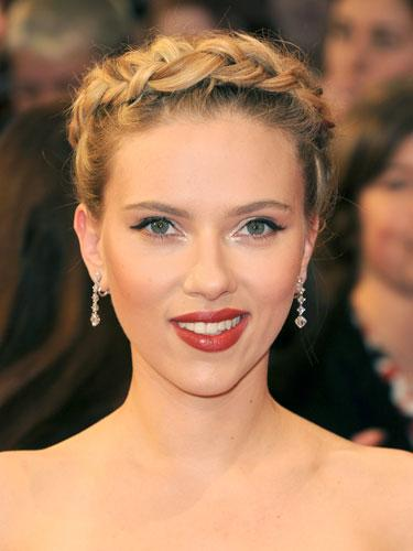 """<div class=""""caption-credit""""> Photo by: Getty Images</div><div class=""""caption-title"""">Scarlett Johansson</div>Johansson's """"halo braid"""" is the romantic look of the season. For your own angelic style, divide hair into three sections, and beginning with the middle one, French braid. Continue clockwise around the hairline until you make your way to the top. """"If it's a little messy and loose, that's okay,"""" says Palacios. """"Once you end the braid, tuck and pin loose ends."""" <br> <br> <b>More from REDBOOK:</b> <br> <ul>  <li>  <a rel=""""nofollow"""" target="""""""" href=""""http://www.redbookmag.com/beauty-fashion/tips-advice/winter-accessories?link=rel&dom=yah_life&src=syn&con=blog_redbook&mag=rbk""""><b>100 Cute, Affordable Winter Accessories</b></a>  </li>  <li>  <a rel=""""nofollow"""" target="""""""" href=""""http://www.redbookmag.com/beauty-fashion/tips-advice/celebrity-makeup-looks?link=rel&dom=yah_life&src=syn&con=blog_redbook&mag=rbk""""><b>The 50 Most Iconic Beauty Looks of All Time</b></a>  </li> </ul>"""