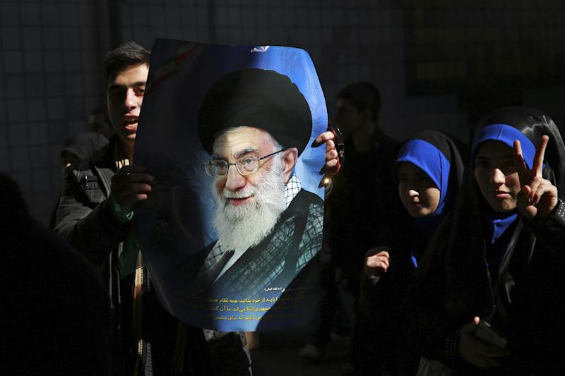 A man holds a poster of the Iranian Supreme Leader Ayatollah Ali Khamenei during an annual rally commemorating the anniversary of the 1979 Islamic revolution, on Azadi (Freedom) Street in Tehran, Iran, Tuesday, Feb. 11, 2014. Tuesday marked the 35th anniversary of the revolution that toppled the pro-U.S. Shah Mohammad Reza Pahlavi and brought Islamists to power. (AP Photo/Ebrahim Noroozi)