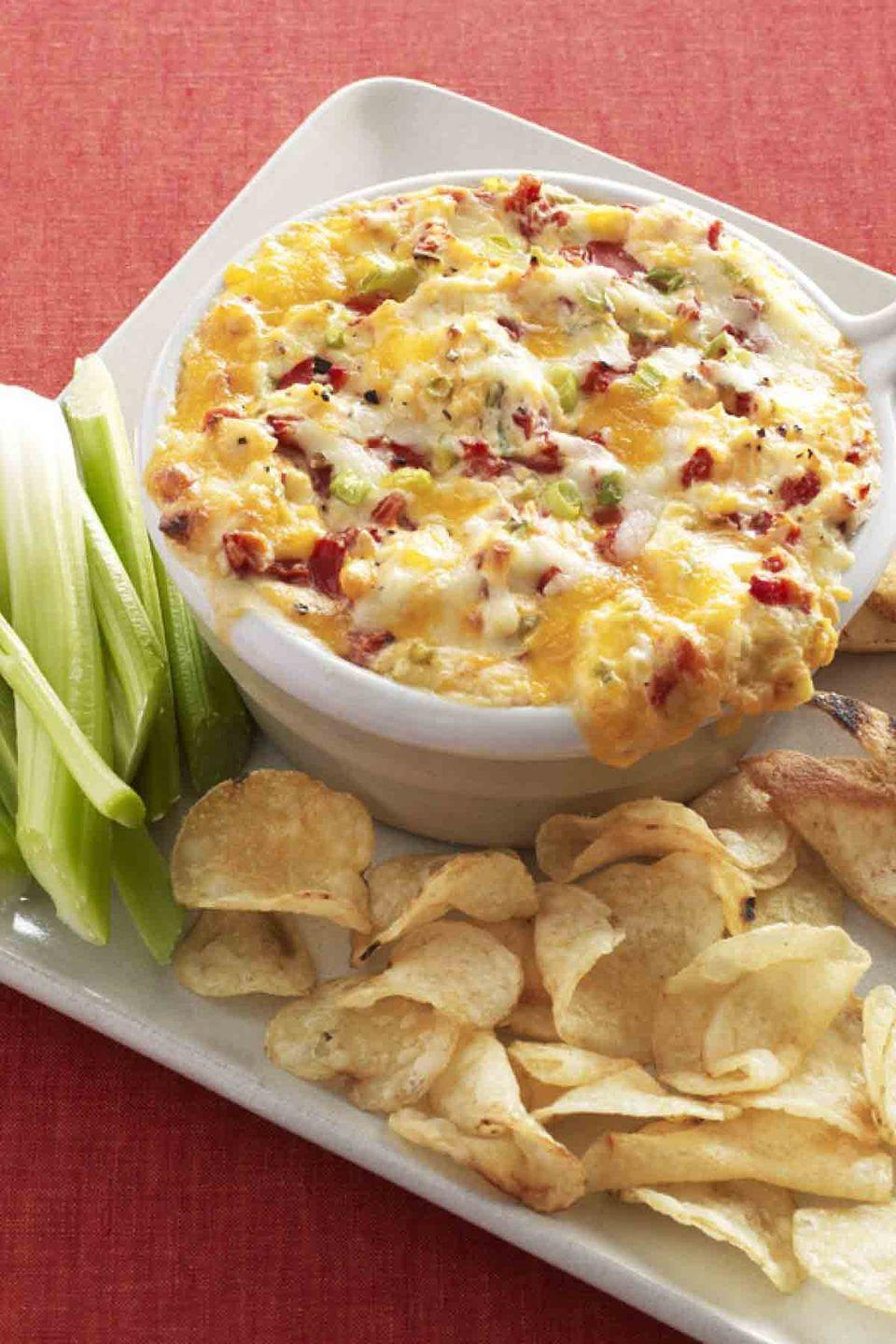 "<p>Prepare this classic Southern dip and your guests will enjoy every warm, cheesy bite. </p><p><strong><a href=""https://www.countryliving.com/food-drinks/recipes/a33699/warm-pimiento-cheese-dip-recipe-wdy1112/"" rel=""nofollow noopener"" target=""_blank"" data-ylk=""slk:Get the recipe"" class=""link rapid-noclick-resp"">Get the recipe</a>.</strong></p>"