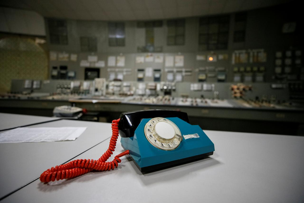 <p>A telephone is seen in a control center of the stopped third reactor at the Chernobyl nuclear power plant in Chernobyl, Ukraine, April 20, 2018. (Photo: Gleb Garanich/Reuters) </p>
