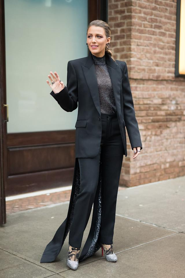 <p>Blake's shimmering tuxedo swept the floor as she exited her building to head to the <b>A Simple Favor</b> premiere. She wore silver Christian Louboutin glitter heels and a mesh turtleneck underneath, accessorizing with Lorraine Schwartz jewels.</p>