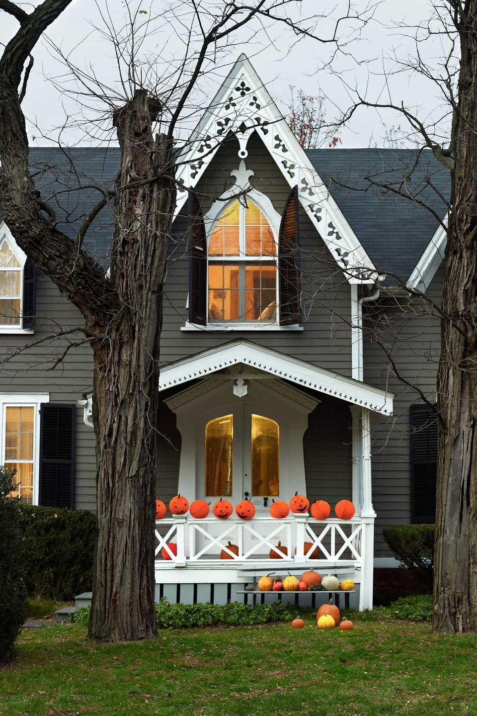 <p>Turn orange tissue-paper balls into proper Halloween pumpkins that can line your front porch. Simply cut facial features and stems from construction paper and apply to the balls with glue dots. </p>