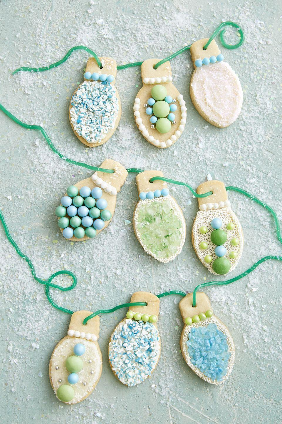 """<p>An assortment of crushed starlight mints, rock candy, dragees, M&M's, and string licorice comes together for some beautiful bulbs. Varying amounts of texture add even more interest.</p><p><strong><a href=""""https://www.countryliving.com/food-drinks/recipes/a40523/christmas-light-sugar-cookies-recipe/"""" rel=""""nofollow noopener"""" target=""""_blank"""" data-ylk=""""slk:Get the recipe"""" class=""""link rapid-noclick-resp"""">Get the recipe</a>.</strong></p><p><a class=""""link rapid-noclick-resp"""" href=""""https://www.amazon.com/dp/B076FFD5RH/?tag=syn-yahoo-20&ascsubtag=%5Bartid%7C10050.g.647%5Bsrc%7Cyahoo-us"""" rel=""""nofollow noopener"""" target=""""_blank"""" data-ylk=""""slk:SHOP COOKIE CUTTERS"""">SHOP COOKIE CUTTERS</a></p>"""