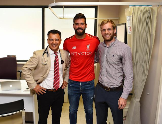 Alisson completes world record move to Liverpool as Roma goalkeeper joins Reds in deal worth £65m