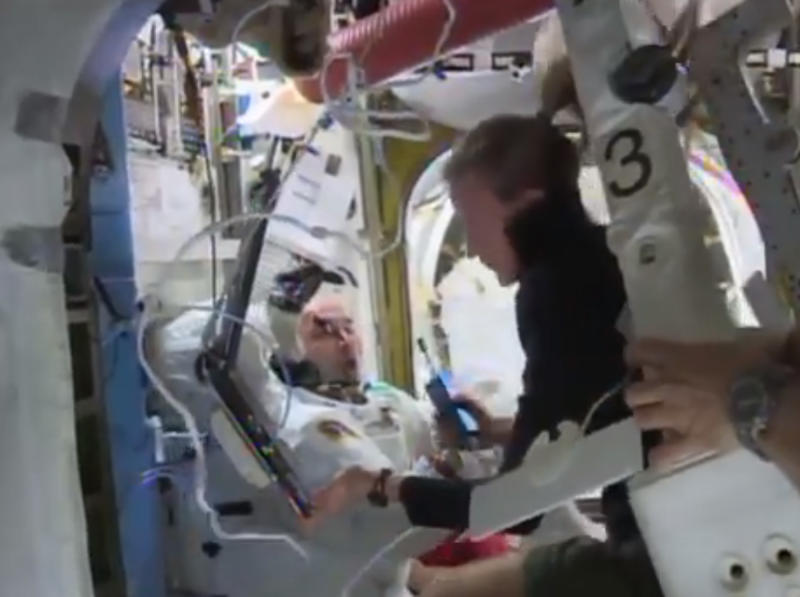 "FILE - In this image from video made available by NASA, astronaut Karen Nyberg assists astronaut Luca Parmitano to remove his space suit aboard the International Space Station after the aborted spacewalk on Tuesday, July 16, 2013. A dangerous water leak in his helmet drenched his eyes, nose and mouth, preventing him from hearing or speaking. In his blog posted Tuesday, Aug. 20, 2013, Parmitano says he couldn't see far and couldn't hear anyone. He frantically tried to think of a plan to get back to the safety of the air lock. That's when he remembered his safety cable. He used the cable recoil mechanism, and its 3 pounds of force, to ""pull"" him back to the hatch. He says it felt like an eternity. (AP Photo/NASA)"
