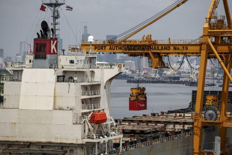 FILE PHOTO: A container is loaded onto a cargo ship at a port in Bangkok