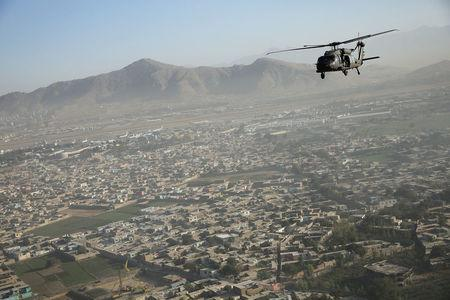 A Blackhawk helicopter flies over Kabul October 3, 2014. REUTERS/Dan Kitwood