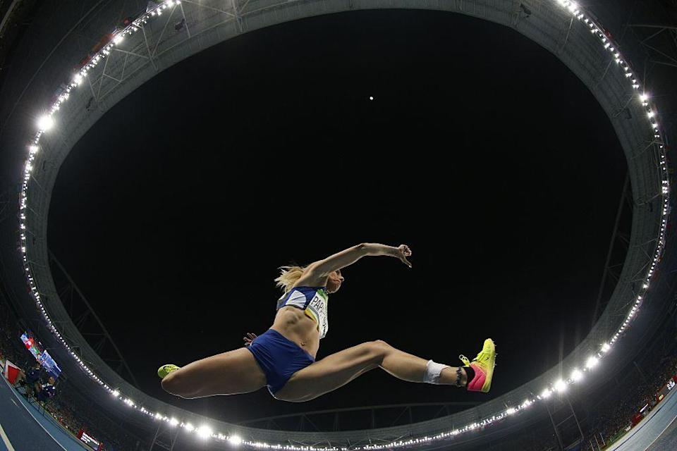 """<p>Greek triple jumper """"Voula"""" Papachristou never made it to the 2012 Olympics due to <a href=""""https://www.bbc.com/news/world-europe-18987678"""" rel=""""nofollow noopener"""" target=""""_blank"""" data-ylk=""""slk:a series of racist Tweets and demonstrated support for far-right organizations on the social media platform"""" class=""""link rapid-noclick-resp"""">a series of racist Tweets and demonstrated support for far-right organizations on the social media platform</a>. The Hellenic Olympic Committee ruled that the posts, which mocked African immigrants, should result in expulsion. </p>"""